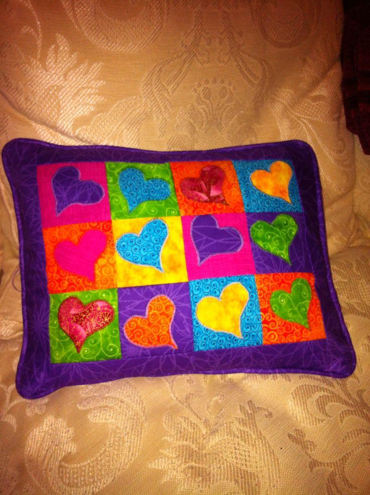 Heart appliqué cushion