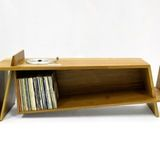 English furniture maker Hugh Miller's Folded Record Bureau is a play on both form and function, incorporating the features of a vintage 1985 Bang & Olufsen BeoGram 5000 turntable, complete with original controls, installed flush into a long record shelf with a fold for magazine storage at one end...