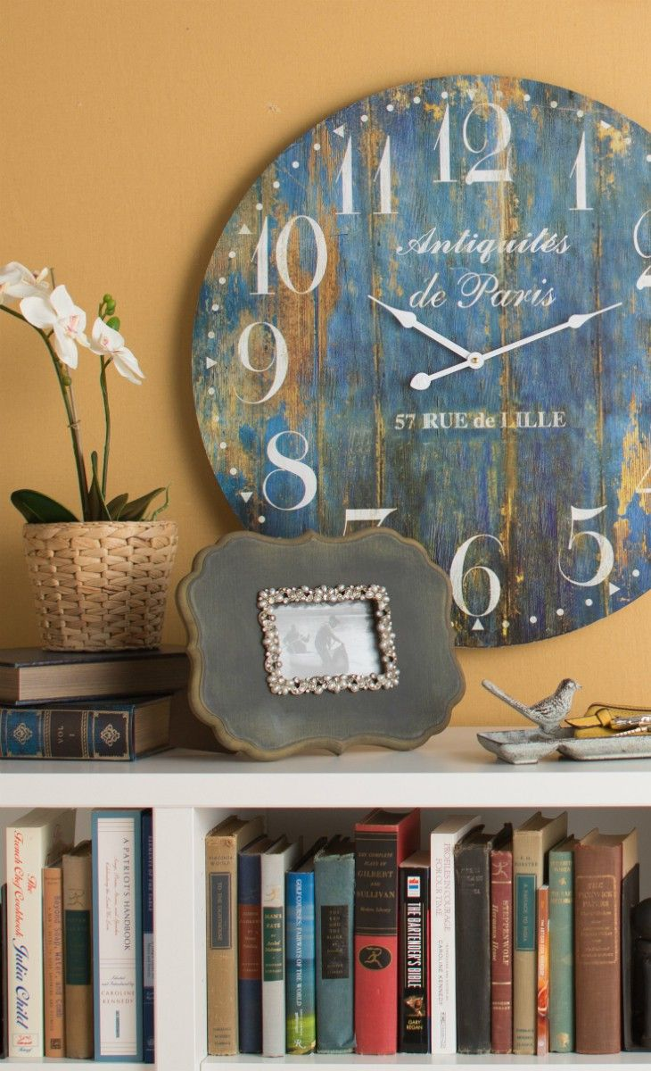 vintage wall clock matching the wallpaper color.