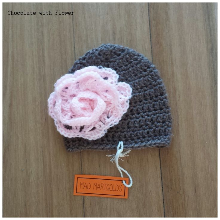 The crochet baby beanies are super soft made with 60% acrylic 40% nylon wool. This size is for 'Premie Baby' measuring approximately 22-24cm head circumference.  Bobble Beanies or Flowers are listed for $10 and Plain Stitch Beanies are $8.
