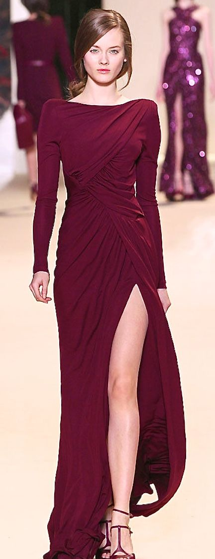 Elie Saab. Love the color and overall shape, but would change it a bit.slit is too high,too many drapings, they make dress look baggy,and body does not looks as good as it can. But I want something similar, if I will not find it , I think I would have to make it.....