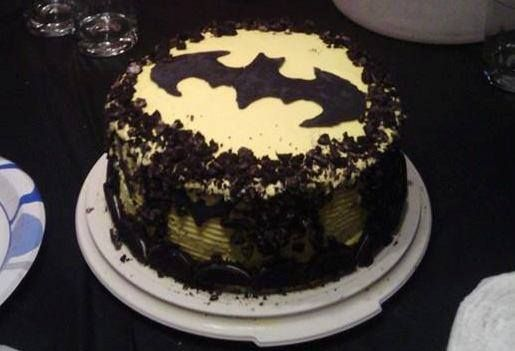 Batman Oreo Icecream cake for my daughter's boyfriend's birthday. Was my 3rd try as I have learned to decorate with lightening speed lol! This cake was SO yummy with french vanilla ice cream 1st layer, with a filling of crushed Oreos and cookies and cream 2nd layer with an Oreo border!