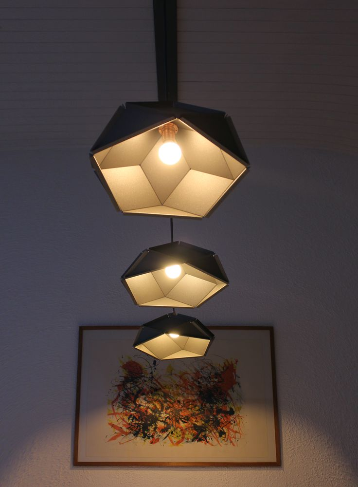 Solid lampshades by Romy Kühne Design joined in one fixture to put above the dinner table. More info? Go to http://www.romykuhne.nl/