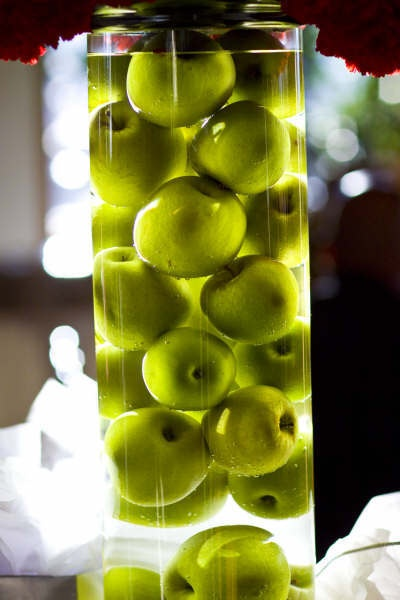 Fall center piece - Apples submerged in water..it'd be really cool with RED apples!