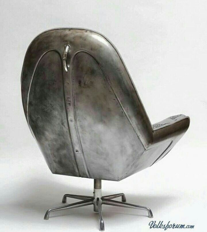 A chair made from a hood of an old VW Beetle. Oh My Gawd, where can I get me one of these???