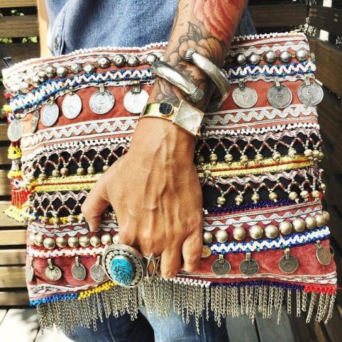 This bag is laden with coins and boho fabric. Love it with the full sleeve tattoo and chunky jewelry.