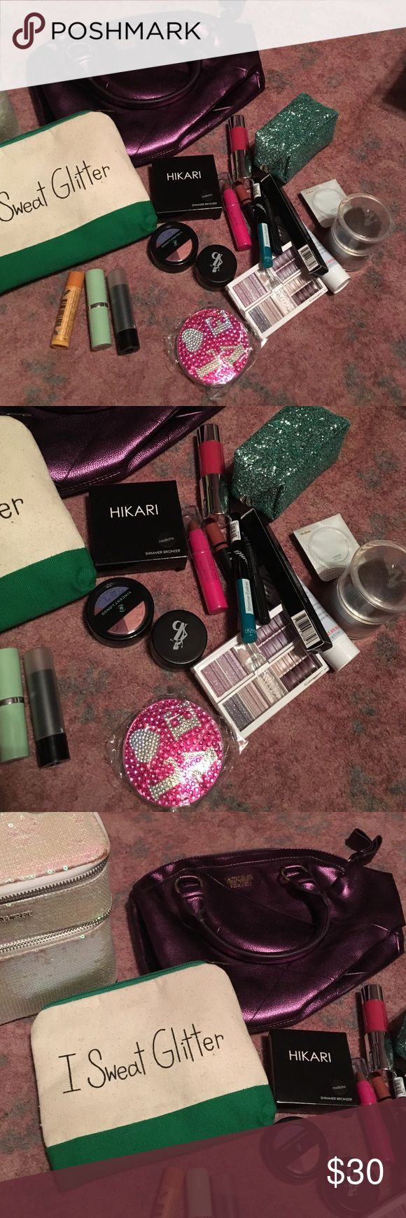 """Makeup Lot!!!! With Victoria Secret Train Case This is a huge makeup lot! You will get a Victoria Secret Train case, $75, a Victoria secret makeup bag, """"I Sweat Glitter"""" bag, a mirror compact(new), a two faced glitter case, and several different makeup items. Some items are new and some have been used. What u see is what you get. I always throw in some extras!!! Need this stuff gone!!! Victoria's Secret Makeup"""