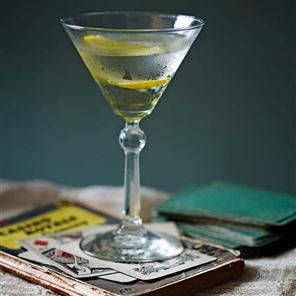 Vesper martini recipe. This famous cocktail taken right out of Casino Royale is a wonderful recipe of gin and vodka – with a garnish of lemon.