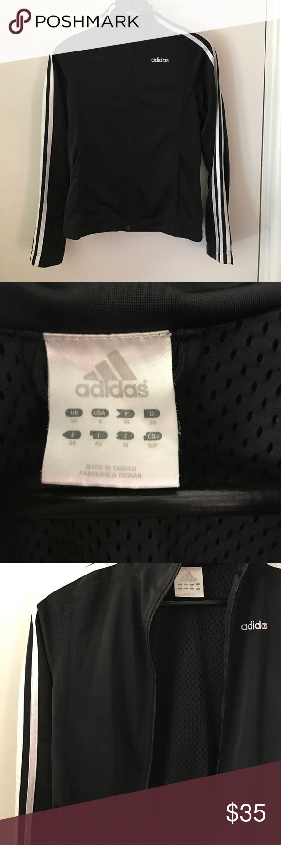 Adidas zip up jacket Standard black adidas jacket with high neck and mesh lining inside. Has signature 3 stripes on sleeves and adidas written on front. In good barely worn condition adidas Jackets & Coats