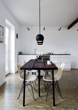 Simple white and timber kitchen/dining area.