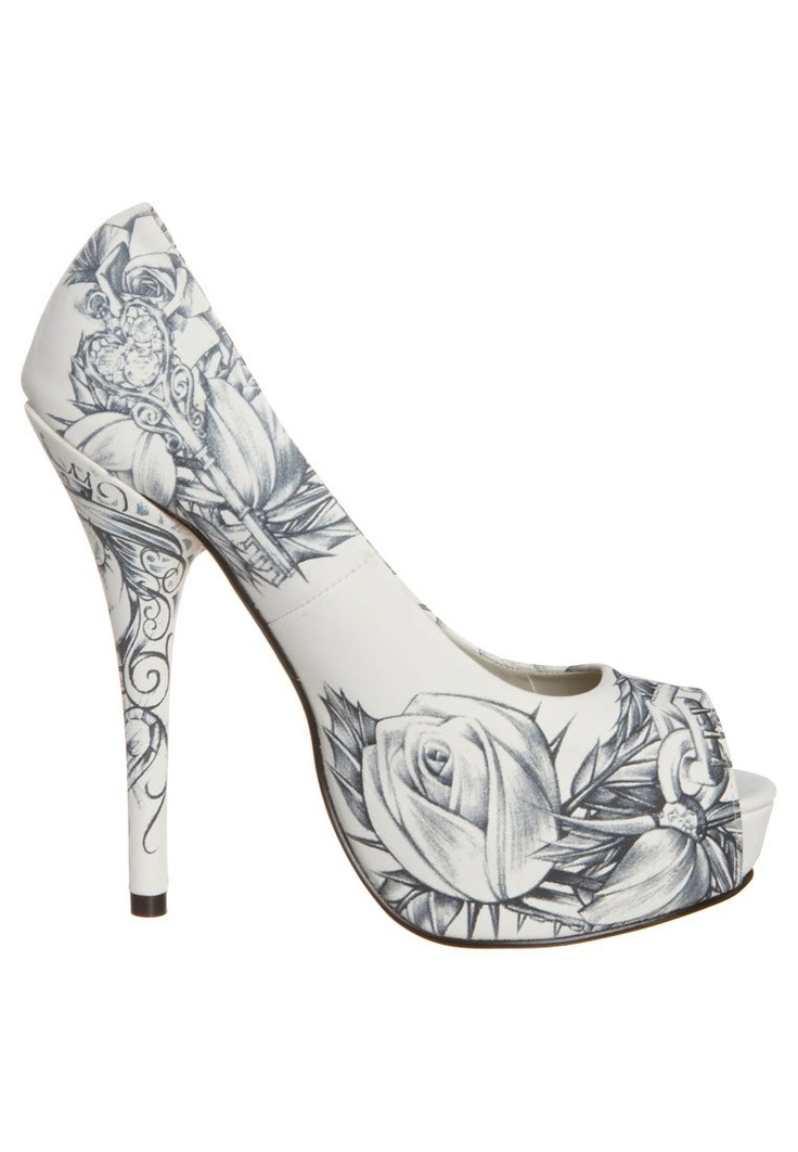 Iron fist heels...omg the ways I could rock these...
