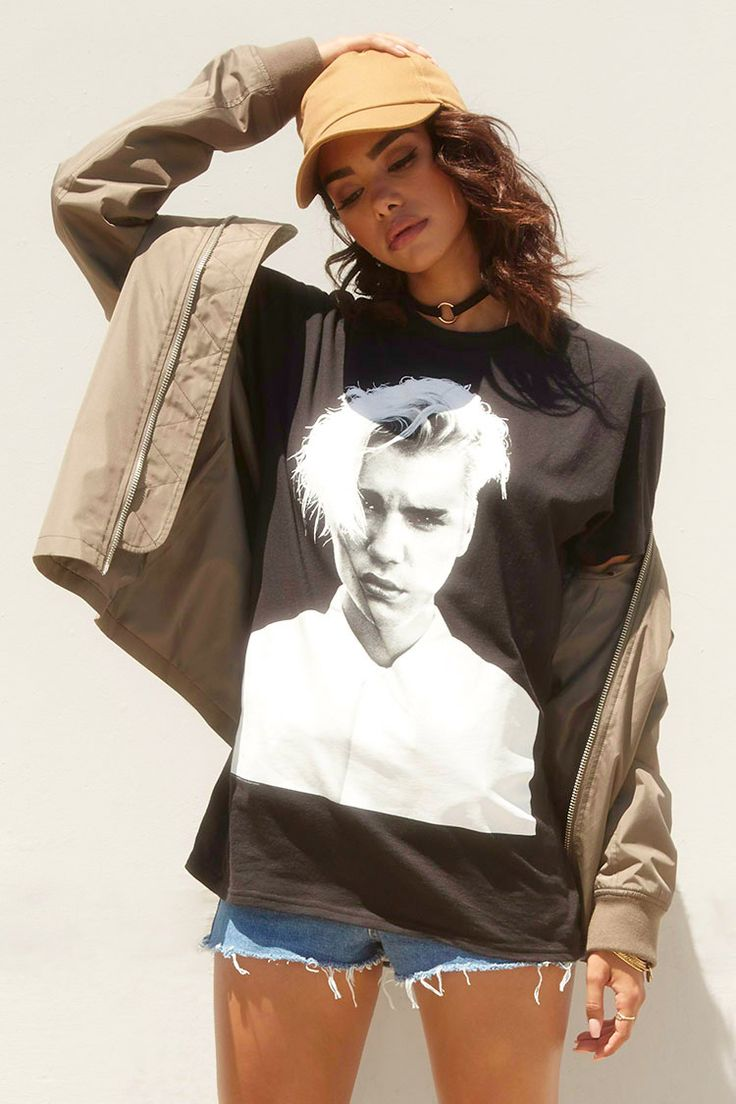 """A knit crew neck tee featuring a large Justin Bieber graphic on the front, and a """"Purpose Tour Merchandise"""" graphic on the back, and short sleeves."""