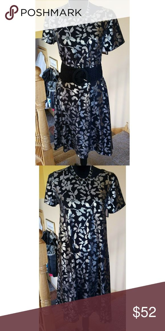 LLR ELEGANT CARLY DRESS  NWOT Gorgeous silver foil over solid black gives this Cay an elegant look.  Belt it wear it unbelted you decide. Dress it up for going out or dress it down. So versatile... LuLaRoe Dresses