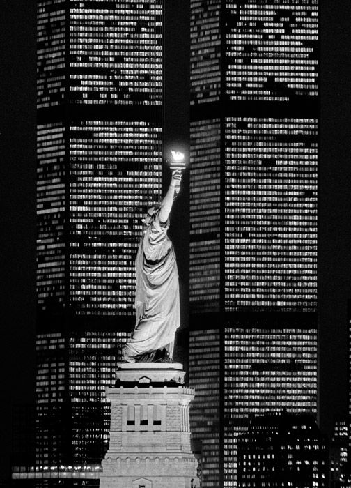"""""""The Statue of Liberty, flanked by the twin towers of the World Trade Center, Dec. 5, 1983. Photo by Fred R. Conrad/The New York Times"""""""