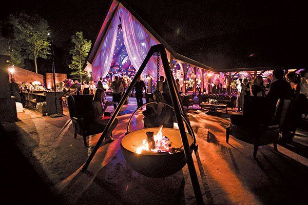 A night under the stars? Keep guests comfortably cozy with ceramic chimineas (small outdoor firepots) or slow-burning fires in low, stone…