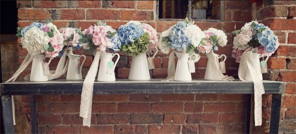 blue and blush pink wedding flowers - bouquets in jugs