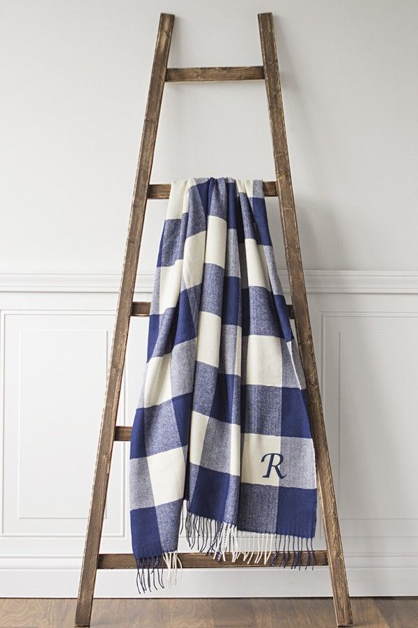 A sunggly blue and white checkered throw blanket for the bride and groom's new forever home. Personalize with the couples new last name initial for a cozy gift the couple can use on a chilly fall night.