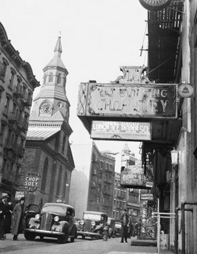 Chop Suey signs and the Church of the Transfiguration in Chinatown in Manhattan - 22 December 1936