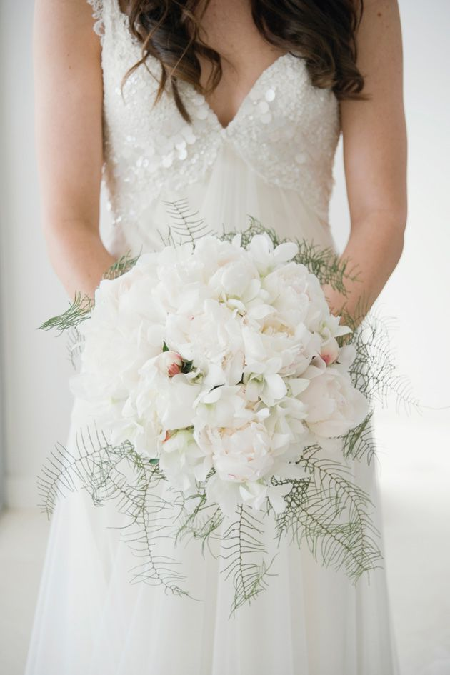 in love with this bouquet of white peonies, with a hint of pink + delicate ferns. CJ Williams Photography