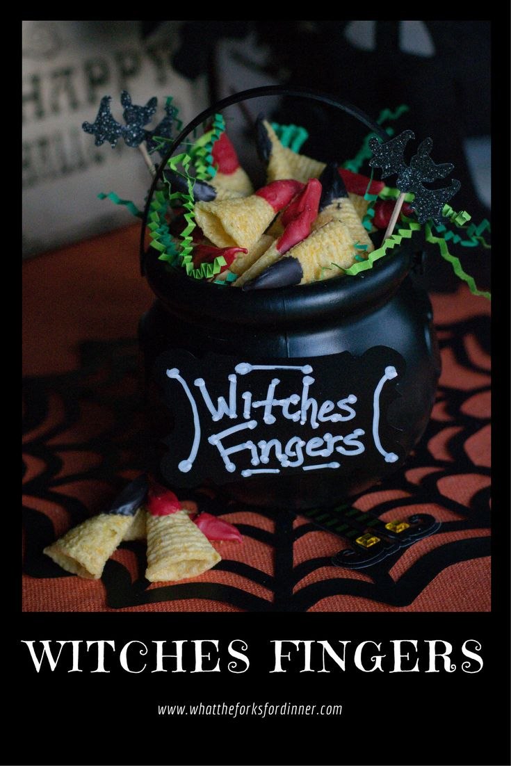Witches Fingers - Sweet and salty snack for your Halloween table. Bugles chips dipped in a colorful candy coating and piled in a cauldron.