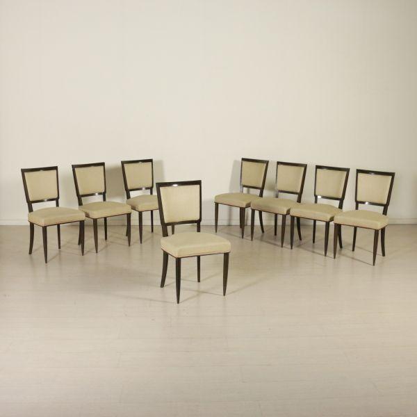 Gruppo di sei sedie; legno di faggio tinto, imbottitura a molle, rivestimento in tessuto.