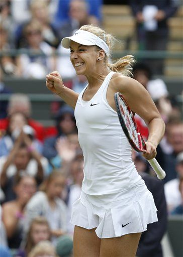 Sabine Lisicki of Germany celebrates defeating Ana Ivanovic of Serbia after their women's singles match at the All England Lawn Tennis Championships in Wimbledon, London, Monday, June 30, 2014. (AP Photo/Ben Curtis) ▼30Jun2014AP|Too much time-wasting, top players says http://bigstory.ap.org/article/wimbledon-watch-berdych-walks-away-dapper-becks #The_Championships_Wimbledon_2014 #Sabine_Lisicki