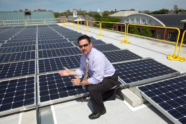 On the roof of the Gordon Indoor Track and Tennis building, workers installed rooftop solar panels as part of what has become Harvard's largest solar energy project. It is part of Harvard's commitment to sustainability and its goal to reduce greenhouse gas emissions 30 percent by 2016 (from a 2006 baseline).