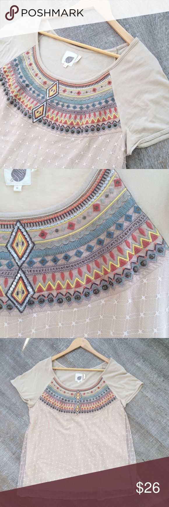 Lilka (Anthropologie) Aztec tee w overlay Gently used Lilka (Anthropologie) Aztec tee w overlay. Tee is 60% Pima cotton (very soft!) and 40% modal. The overlay is 100% mesh nylon. Size M. Offers welcome! Anthropologie Tops Tees - Short Sleeve