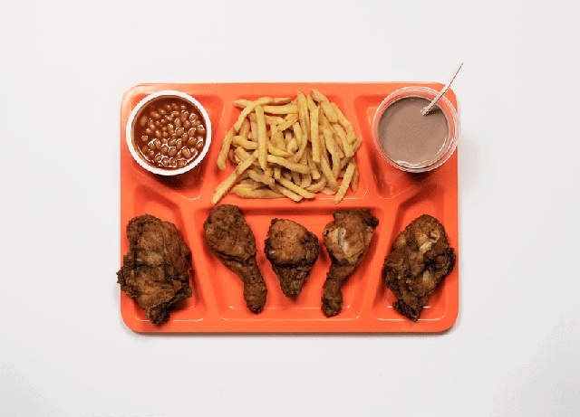 Last Suppers series by James Reynolds, displaying the last meals requested by criminals on death row. This one shows the KFC meal requested by notorious serial killer John Wayne Gacy before his execution in 1994.