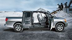 Open up a whole new world with the 2015 Nissan Titan! - Nissan Titan® SV King Cab 4x4 shown in Gun Metallic.