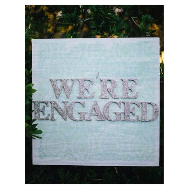 """ We're engaged "" sign handmade and designed by Tessa, available for hire. Custom designs can also be made to order, for details please contact Sue and Tessa via willowandvinehire@gmail.com #willowandvine #event #eventstyling #wereengaged #engagement #party #celebration #mint #silver #glitter #canvas #art #prophire #customdesigned"