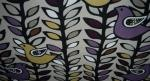 MCM upholstery fabric. Scandinavian bird/tree design with plum, ivory, black, and lime colors.