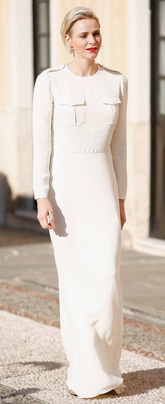 Princess Charlene attends the Monaco Palace cocktail party in June in a floor-skimming gown complete with military detailing
