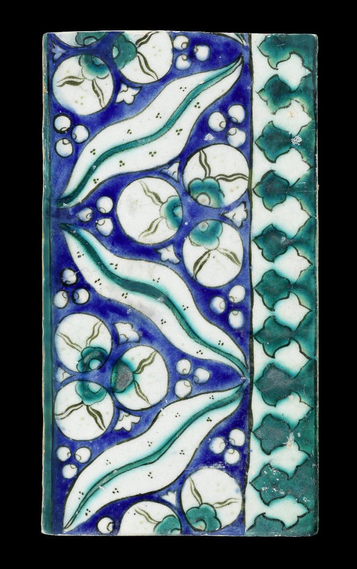 A Damascus cintamani design underglaze-painted pottery Border Tile  Syria, circa 1600 rectangular, decorated in turquoise, black and cobalt-blue with a band of cintamani motifs reserved on a cobalt-blue ground, above a frieze of trefoils reserved on a turquoise ground
