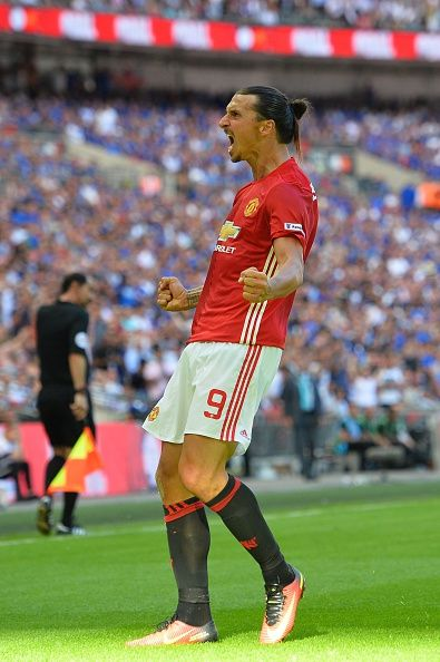 Manchester United's Swedish striker Zlatan Ibrahimovic celebrates scoring their second goal during the FA Community Shield football…
