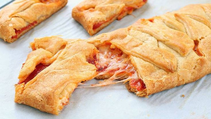 There's no wrong way to eat a pizza, but this crescent version is super fun and guaranteed to please.