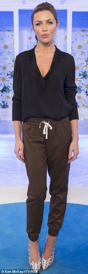 Abbey Clancy.. sporty n' chic.. Topshop patch pocket joggers with Isabel Marant heels..