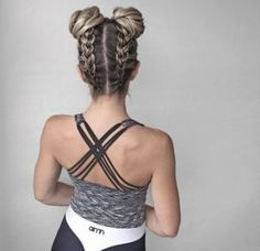Double upside down braided buns by Nina Starck