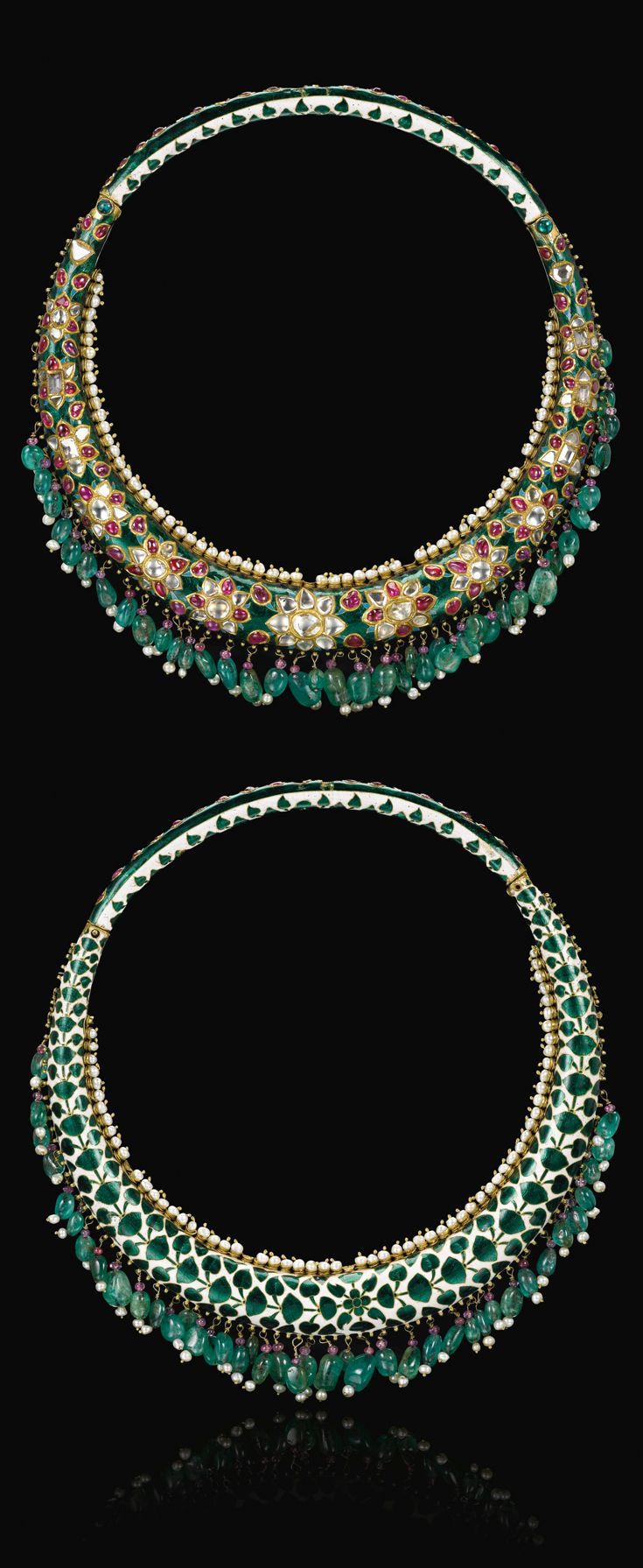 India ~ Rajasthan, Bikaner Maharani torque necklace (Hasli); diamonds, rubies and emeralds set in green enamel using the kundan-mina technique with an inner edge of pearls set in gold cups and an outer fringe of emerald beads, the reverse decorated with a row of green enamel leaves on a white ground   | Late 19th century | Est. 250'000 - 300'000£ ~ (Sept '14)