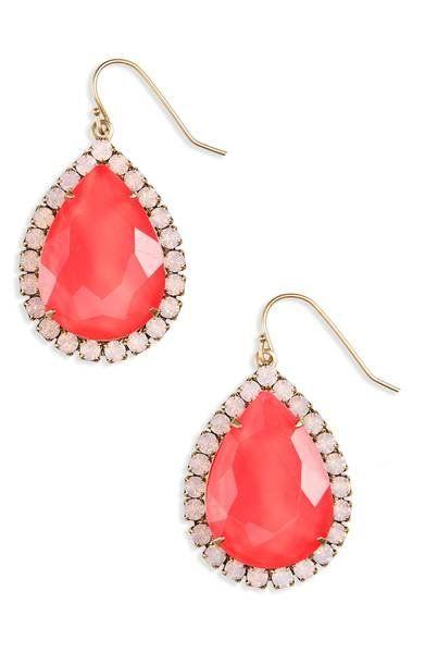 Teardrop jewels haloed in crystal add regal flicker to mid-size earrings.