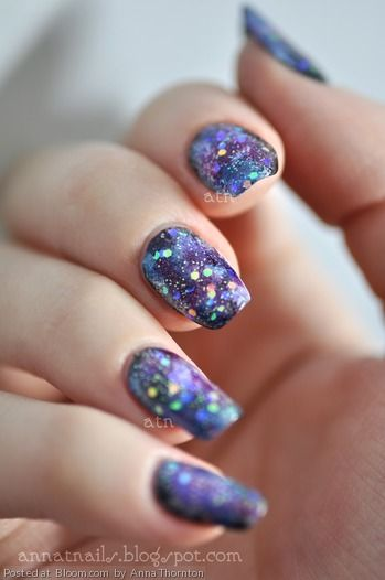 painted my nails a base coat of black. then using a makeup sponge  sponged on different colors randomly to get a galaxy effect!