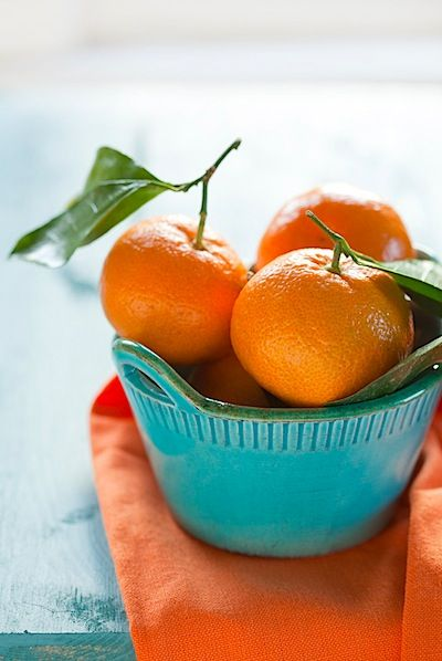 Yes this is a bowl of fruit - I like the orange + turquoise combo! Wear it!