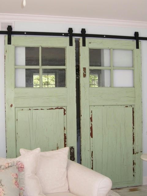 a great over sized pair with an appealing color paint. Measure to make sure they would fit your opening. Use them as slider doors between a doorway opening. The trick is getting the right hardware and hanging them