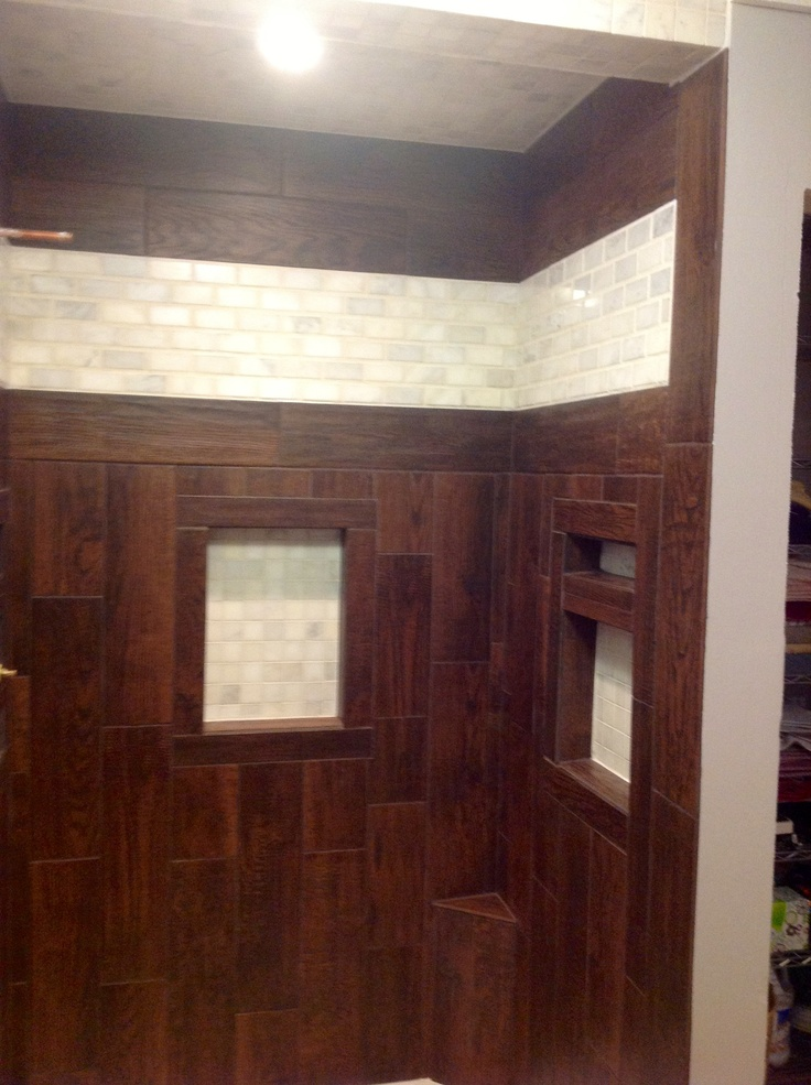 Shower Stall.Ceramic Tile That Looks Like Wood. Also Used White Marble  Subway Tile