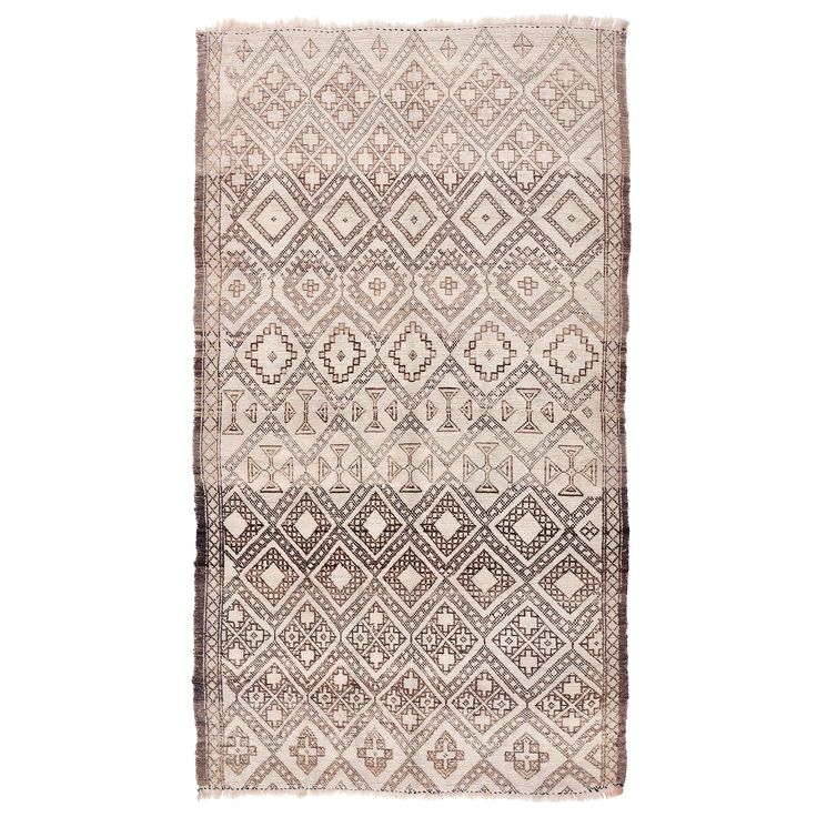 Concentric diamond designs and graphic tribal motifs create an intriguing and dramatic effect on this vintage wool rug. Handwoven in Morocco, the cream field and a rich chestnut palette completes the overall tribal aesthetic. Steeped in centuries of tradition and craftsmanship, the weaving heritage of Moroccan tribes creates unique pieces that are rich in history, cultures, and color - exotic additions to today's modern interiors.<br/><br/>Culled from an exclusively ...
