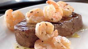 Surf & Turf on the Grill featuring Shrimp Scampi and Sirloin Steak - This easy surf and turf recipe shows you how to cook great steak and shrimp on the grill. Schwan's meal ideas for dinner make weeknight cooking simple. #Schwans