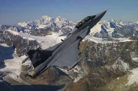 Royal Swedish Air Force Saab Gripen fighter, over Swiss Alps, during test flights for acceptance for Swiss Air Force.