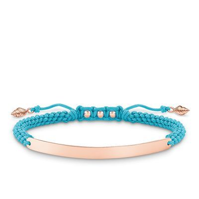 Seashells, rose gold and blue macramé... this bracelet is the epitome of casual seaside chic. Add personal flair with customizable engraving. #THOMASSABO #LOVEBRIDGE