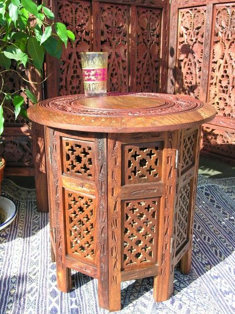 Small inlaid wooden table. http://www.maroque.co.uk/showitem.aspx?id=ENT00203&p=01570&n=all