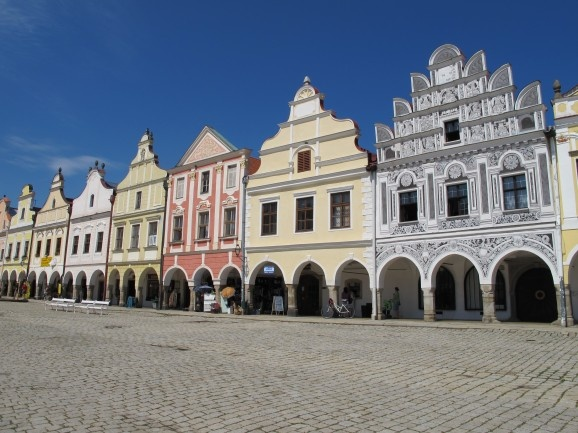 The main square in Telč, Czech republic is a UNESCO World Heritage Site and contains rows of beautifully painted Renaissance and Baroque houses with high gables and arcades. Taken by Talmadge O'Neill